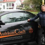 Aufräumcoaching mit Rita Schilke: Foto mit Auto und Schriftzug Aufräumcoach